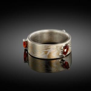 Mokume gane ring (yellow gold/silver) with orange garnets
