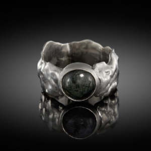 Silver ring, cast in soapstone, with rutilated quartz