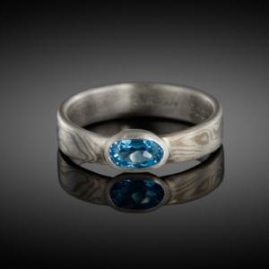 Mokume gane ring (white gold/silver) with blue topaz