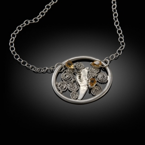 'Adrift'. Mokume gane pendant (silver/yellow gold) with citrines and filigran detail