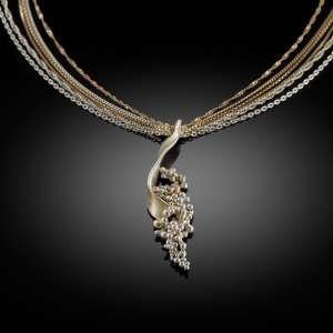 'Sequence'. Mokume gane necklace (yellow gold/silver) with granulation